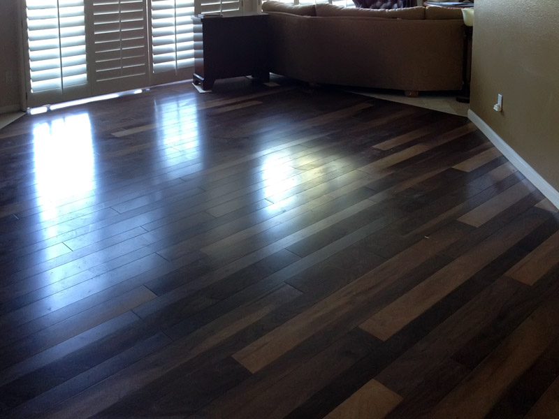 Tile Flooring With The Look Of Real Wood Tops In Stone LLC - Dark brown tile that looks like wood